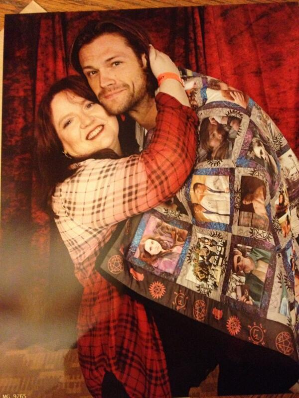 Jared and @thebounds pose with the quilt - photo used with permission