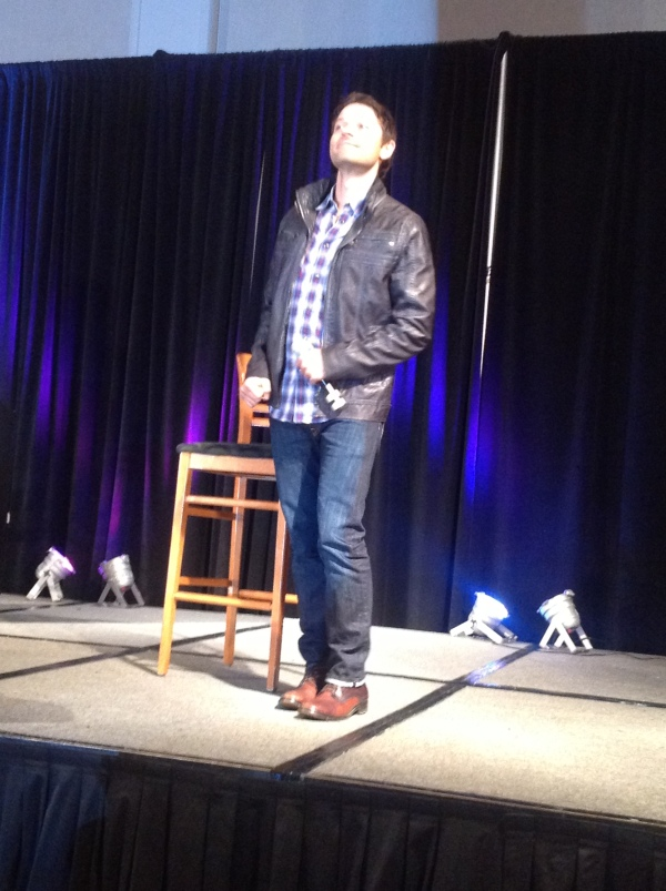Misha Collins dances onstage