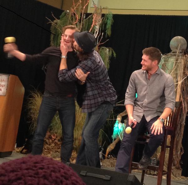 Smack! Jared plants one on Richard while Jensen looks on