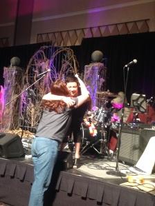 Kim hugs a fan