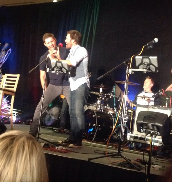 Jensen can't resist singing with the band