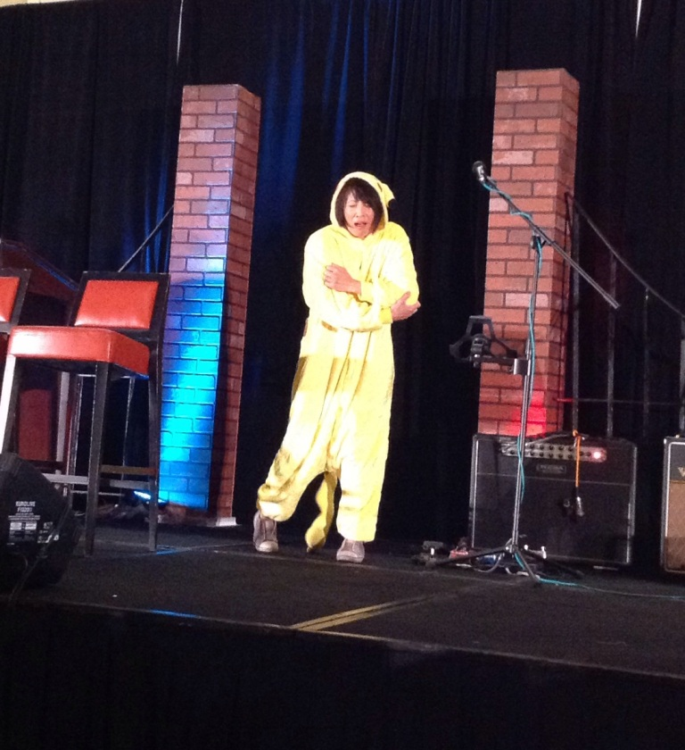 Lauren onstage at ChiCon cosplaying Pikachu