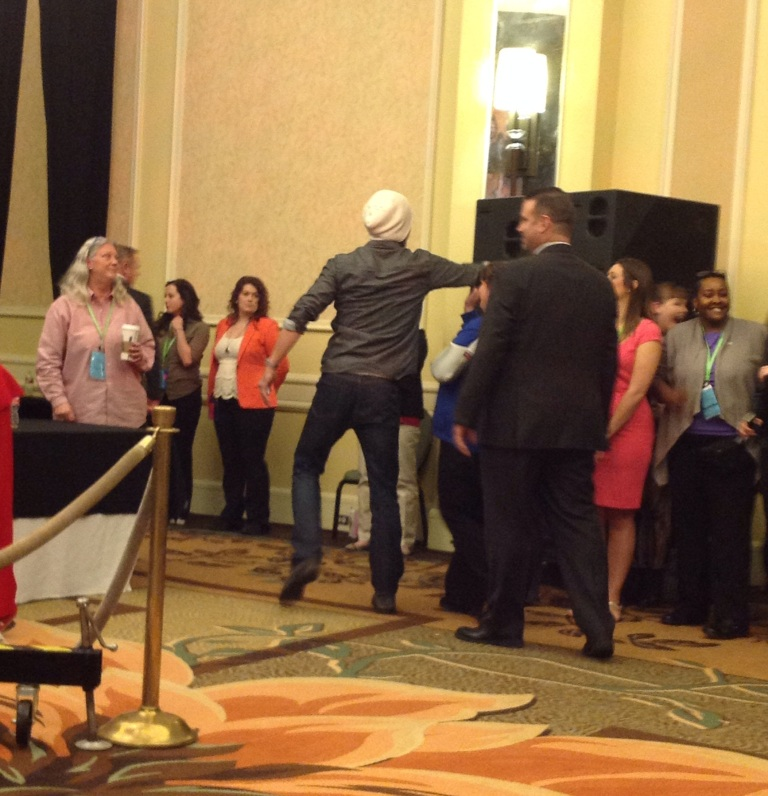 Jared high fives fans on his way offstage